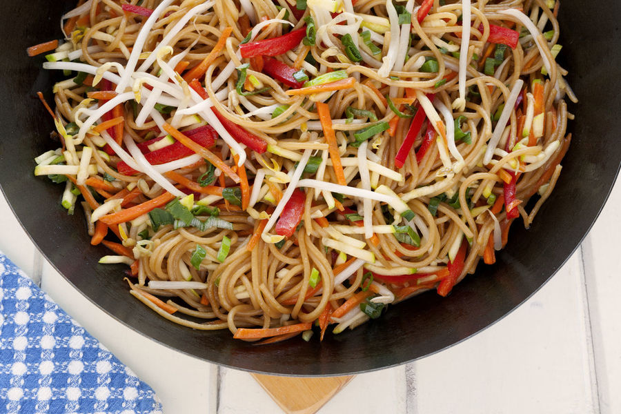 Wok Food. Asian Style pasta sauteed with vegetables. Asian Style Asian Style Food Blue Napkin Carrots Checkered Napkin Chow Mein Close-up Day Food Food And Drink Healthy Eating Indoors  No People Pasta Ready-to-eat Red Pepper Soy Sauce Soybean Sprouts Sprouts Studio Shoot Vegetable White Background Wok Wok Food Zucchini Food Stories