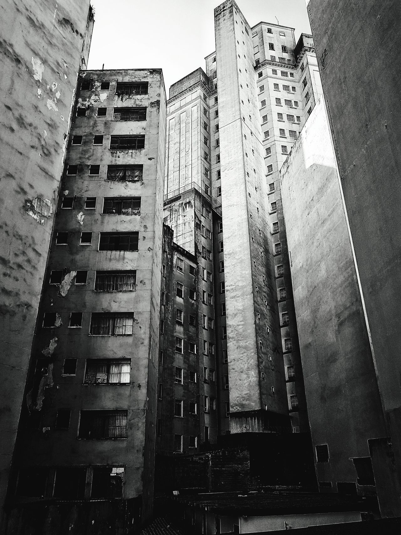Skyscraper Architecture Built Structure Building Exterior City Low Angle View No People Day Travel Destinations Outdoors Apartment Black And White Blackandwhite Architecture City Building Building Structures Damaged Rusty Worn Out