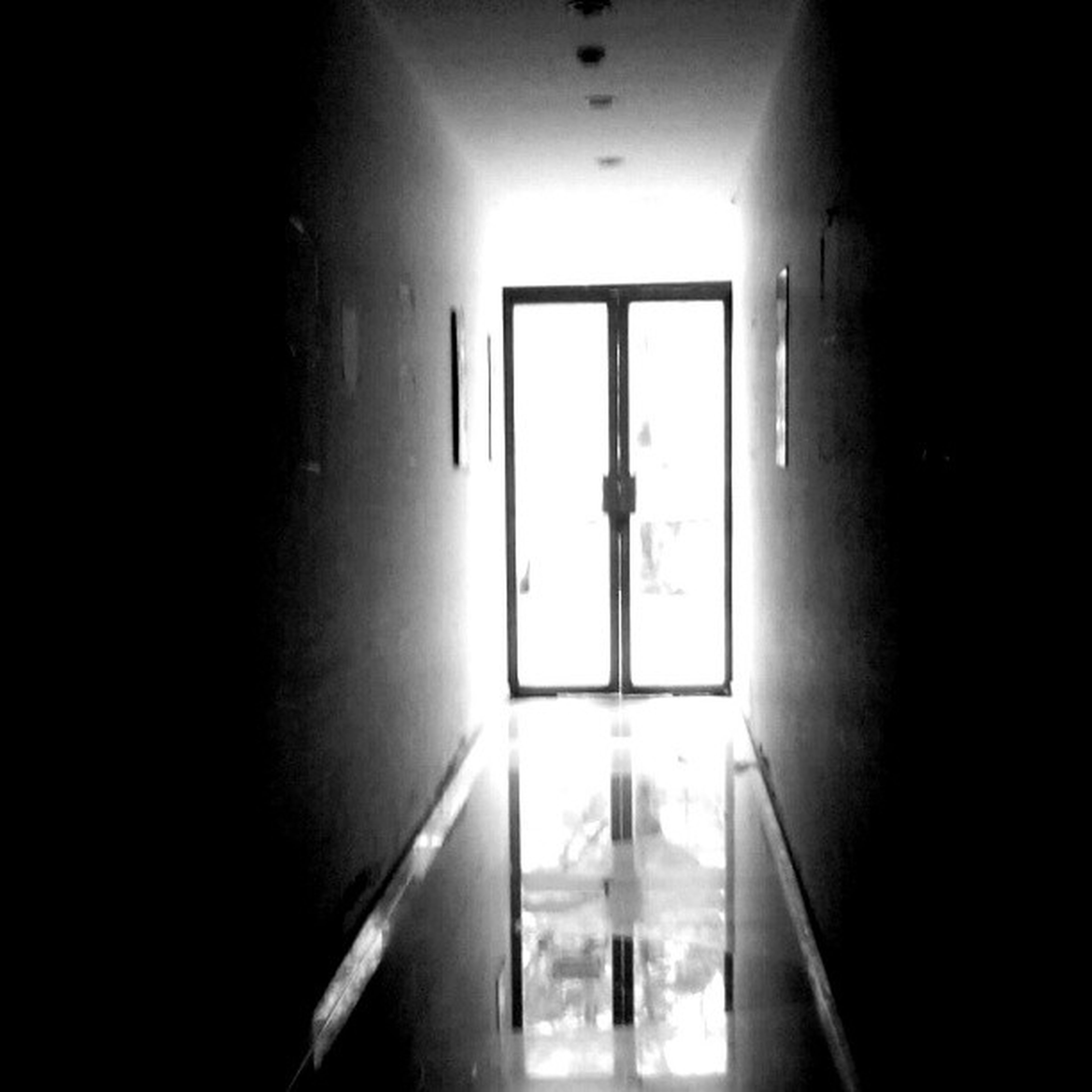 indoors, illuminated, window, door, wall - building feature, built structure, dark, architecture, corridor, lighting equipment, home interior, wall, light - natural phenomenon, house, sunlight, room, domestic room, doorway, one person, the way forward