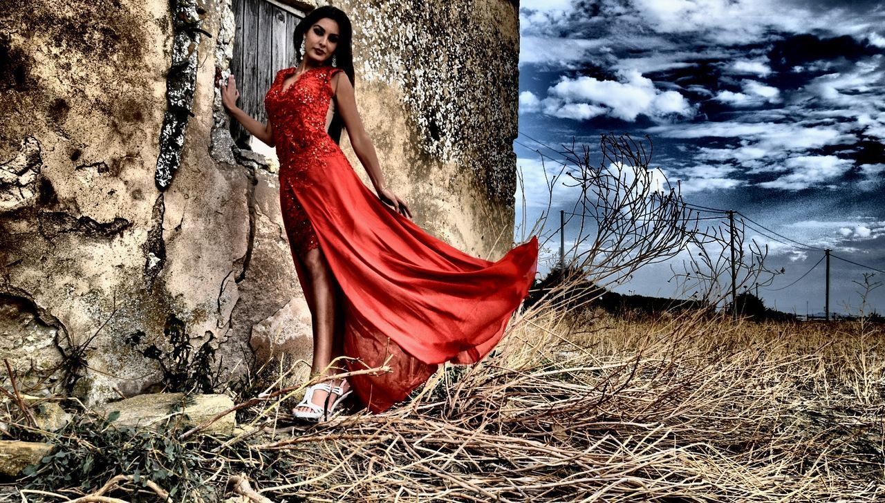 dress, red, beautiful woman, women, one person, real people, beauty in nature, outdoors, full length, beautiful people, evening gown, young women, day, beauty, fashion model, looking at camera, tree, formalwear, one woman only, portrait, only women, adult, glamour, young adult, nature, one young woman only, sky, adults only, people