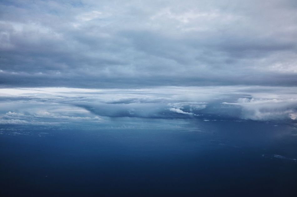 shades of blue somewhere above Southeast Sulawesi Sea Horizon Over Water Horizon Blue Cloud - Sky Scenics Aerial View Water Day Storm Cloud Sky From An Airplane Window Flying Traveling ASIA INDONESIA Sulawesi Blue Color Tropical Weather Tropical Climate