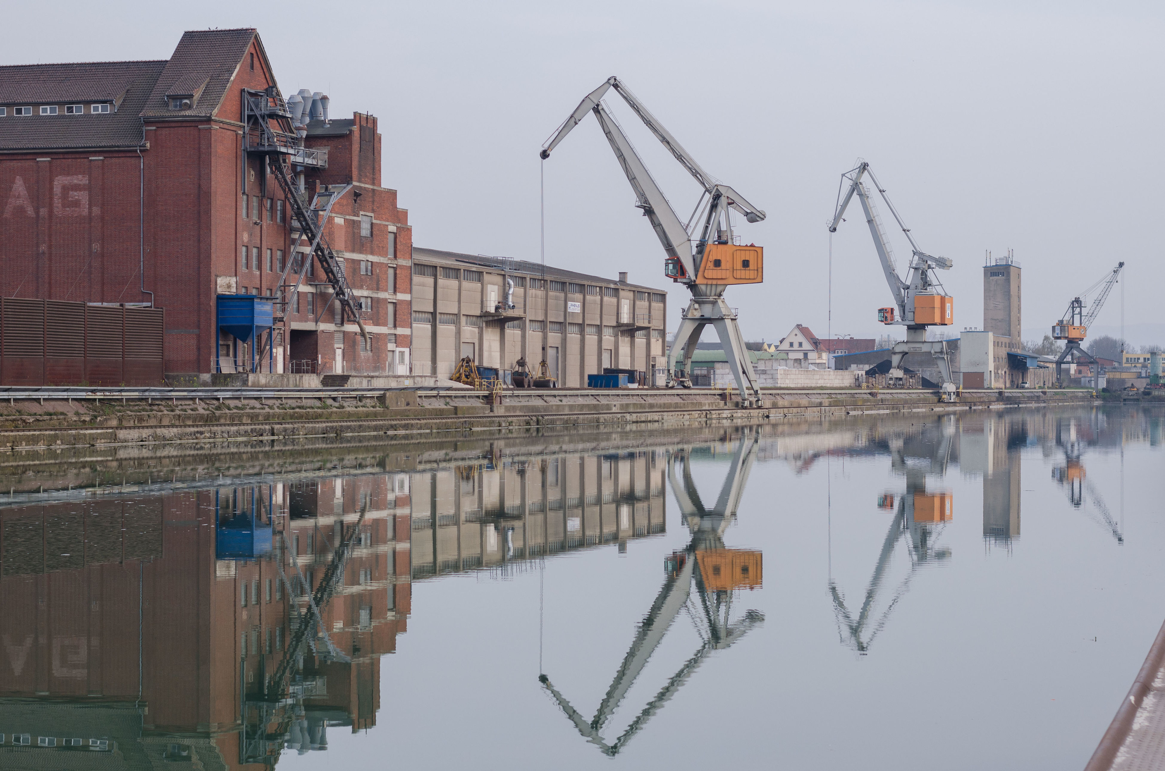 crane - construction machinery, built structure, architecture, building exterior, water, construction site, harbor, crane, industry, development, moored, clear sky, nautical vessel, commercial dock, construction, waterfront, mast, transportation, reflection, fuel and power generation
