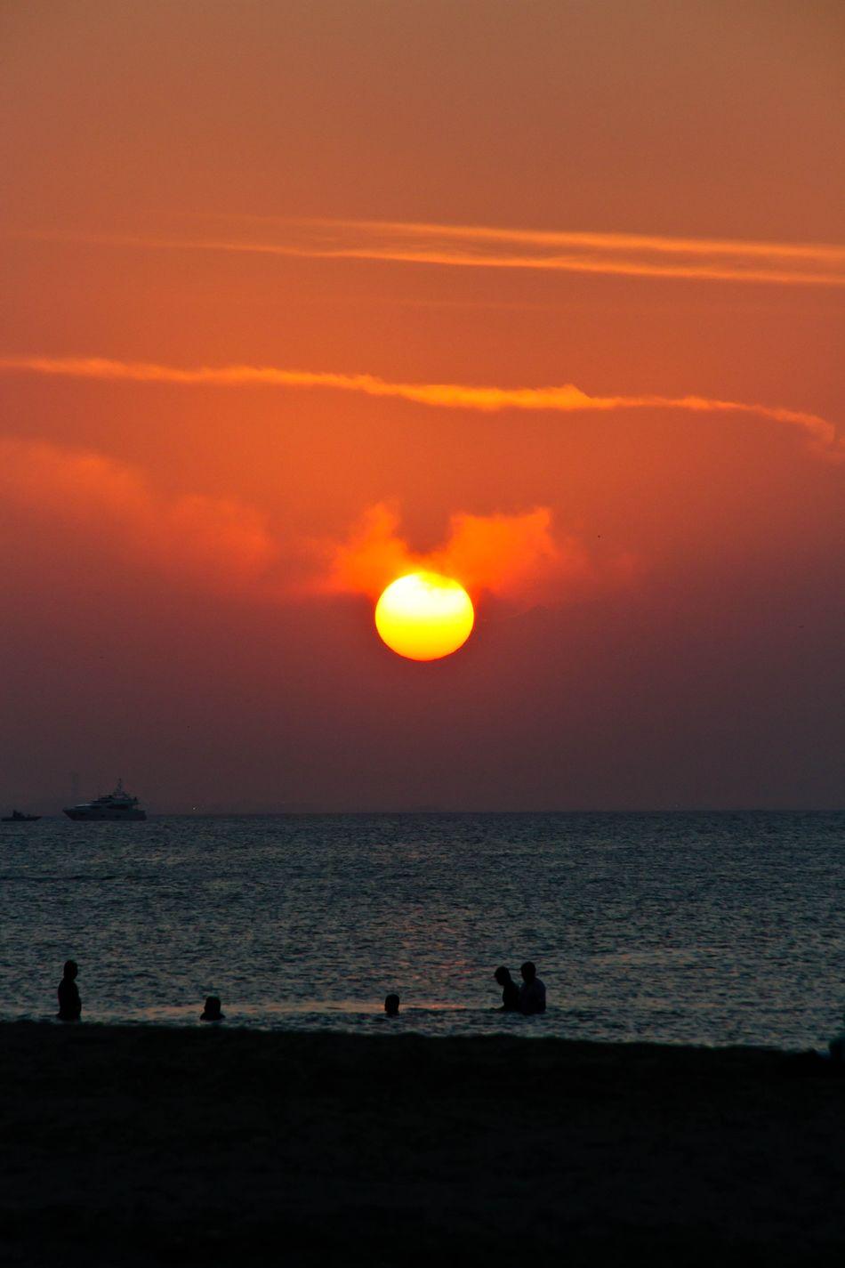 Oman Beach Sunset_collection Sunset Sunset Silhouettes Sunset Beach Orange Sun People Bathing Sea Ocean
