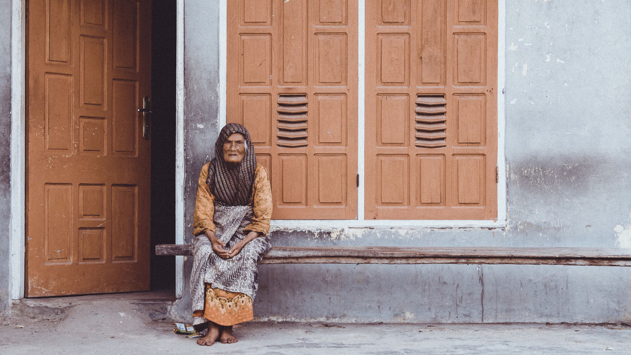 Old woman sitting in front of her house. The colors of the house matching her clothes caught my eye immediately. ASIA Beautiful People Brown Character Color Palette Culture Females Front Door Fujifilm Gray House INDONESIA Looking At Camera Muslimah Old Woman One Person Outdoors People Of EyeEm Portrait Southeastasia Streetphotography Vintage Warm Clothing Wood - Material