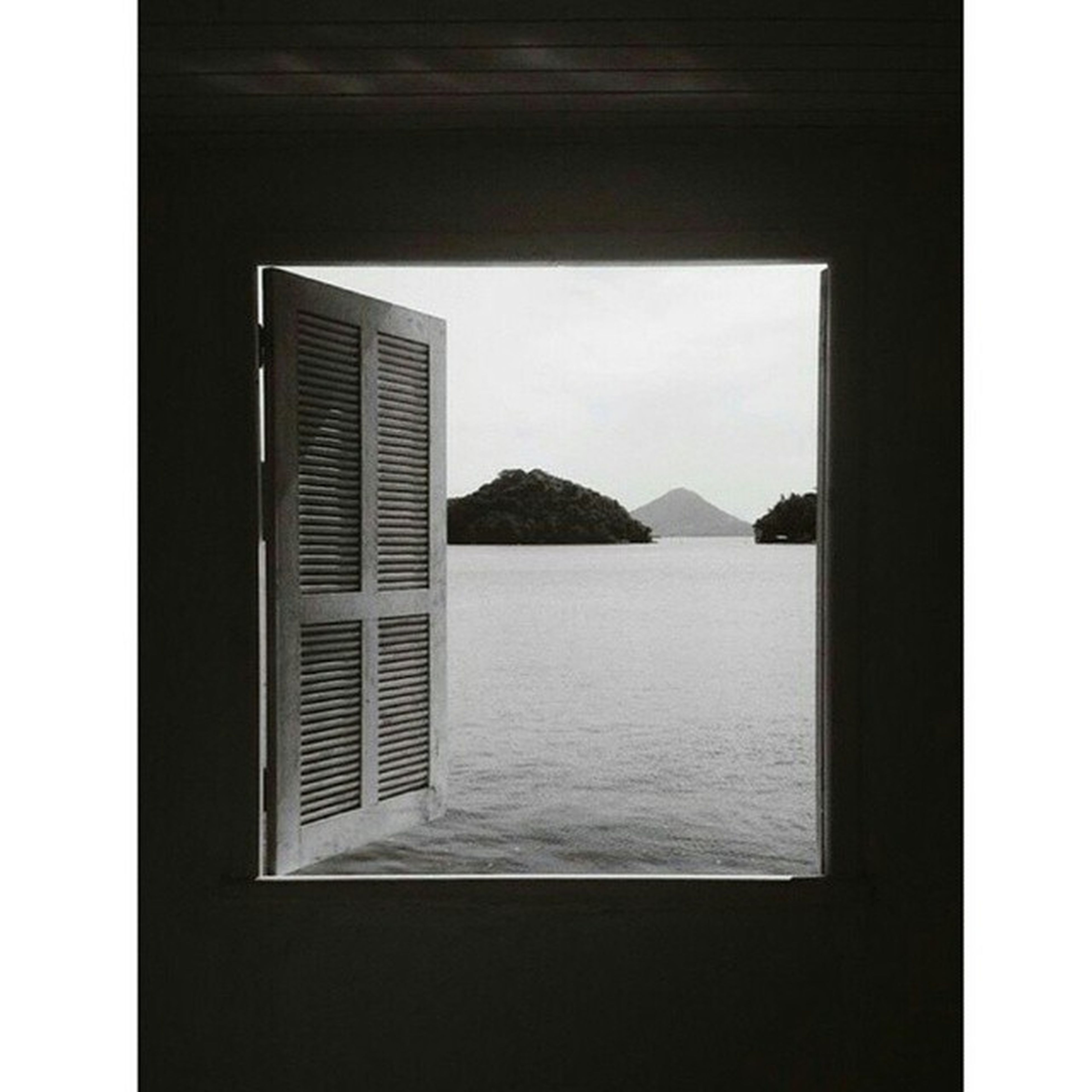 transfer print, water, sea, window, built structure, indoors, mountain, auto post production filter, architecture, sky, clear sky, scenics, tranquil scene, tranquility, day, nature, waterfront, beauty in nature, copy space, no people