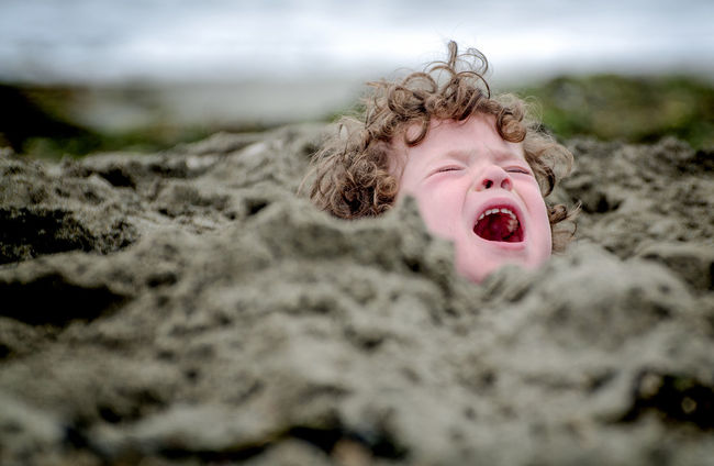 Angry Buried Buried In Sand Child Close-up Cute Day Drowning Emotions Focus On Foreground Mad Nature Outdoors Portrait Screaming Selective Focus