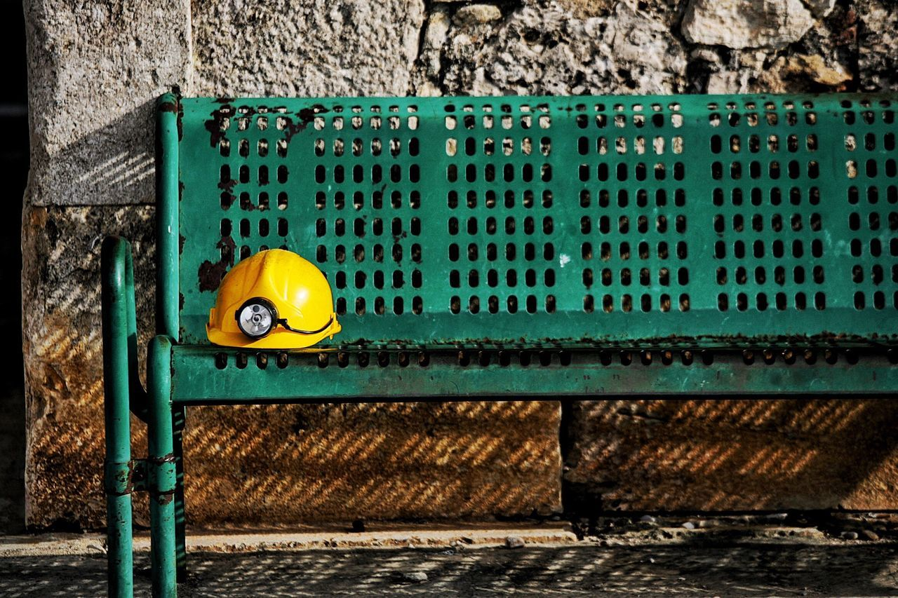 Mining Mining Industry Mining Exploration Mining Helmet Safety Helmet Hard Hat Spelonk Safety Yellow Helmet Fresh On Eyeem  Bench At Rest Jobless Searchlight Torchlight Green Green Color Shadows Afternoon Shadow Anxious  Anxiety  TakeoverContrast Mining Helmet Bench View