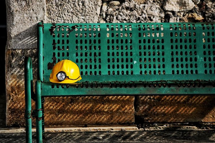 Mining Mining Industry Mining Exploration Mining Helmet Safety Helmet Hard Hat Spelonk Safety Yellow Helmet Fresh On Eyeem  Bench At Rest Jobless Searchlight Torchlight Green Green Color Shadows Afternoon Shadow Anxious  Anxiety  TakeoverContrast Mining Helmet Bench View Paint The Town Yellow