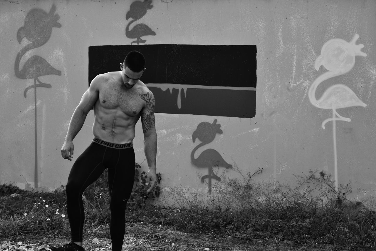 Day Leisure Activity Lifestyles Men Muscular Build One Person Outdoors Real People Shirtless Standing Strength Young Adult