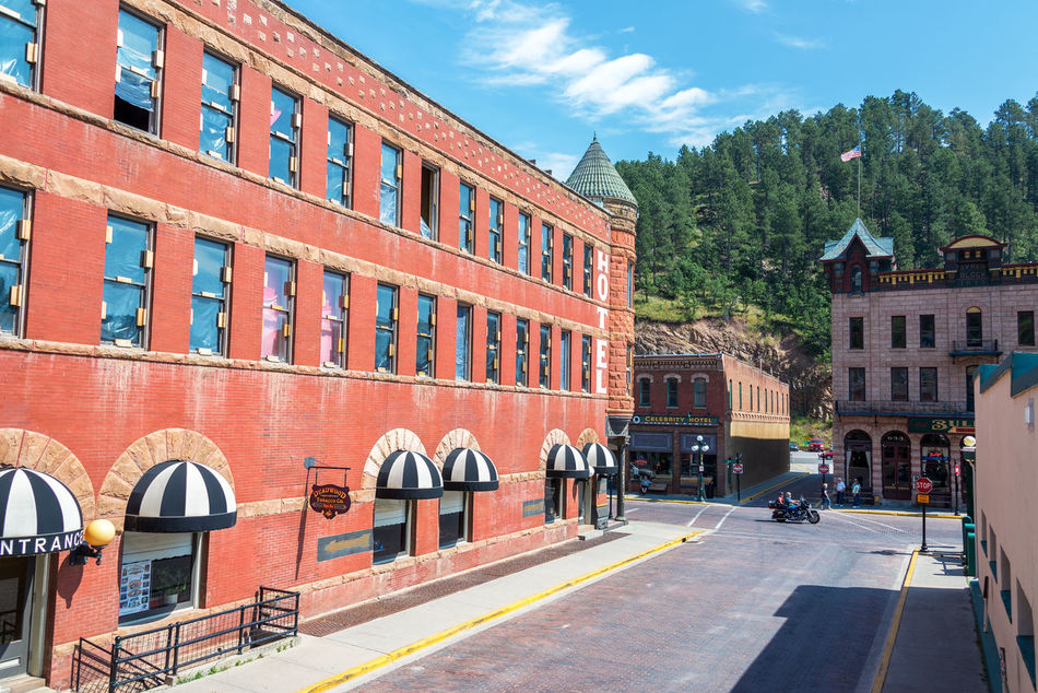 DEADWOOD, SD - AUGUST 26: View of Main Street in Deadwood, SD on August 26, 2015 Architecture Bar Black Hills Brick Building Exterior Casino Deadwood  Downtown Historic Hotel Old West  People Restaurant Road Sky South Dakota Tavern  Tourism Tourists Town Travel Travel Destinations USA Western Wild West