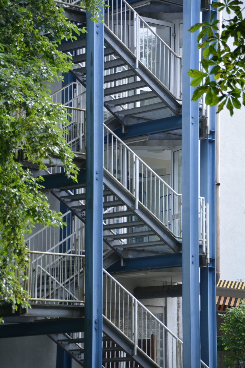 staircase, railing, steps and staircases, steps, architecture, stairs, built structure, fire escape, building exterior, spiral, spiral stairs, no people, outdoors, hand rail, day
