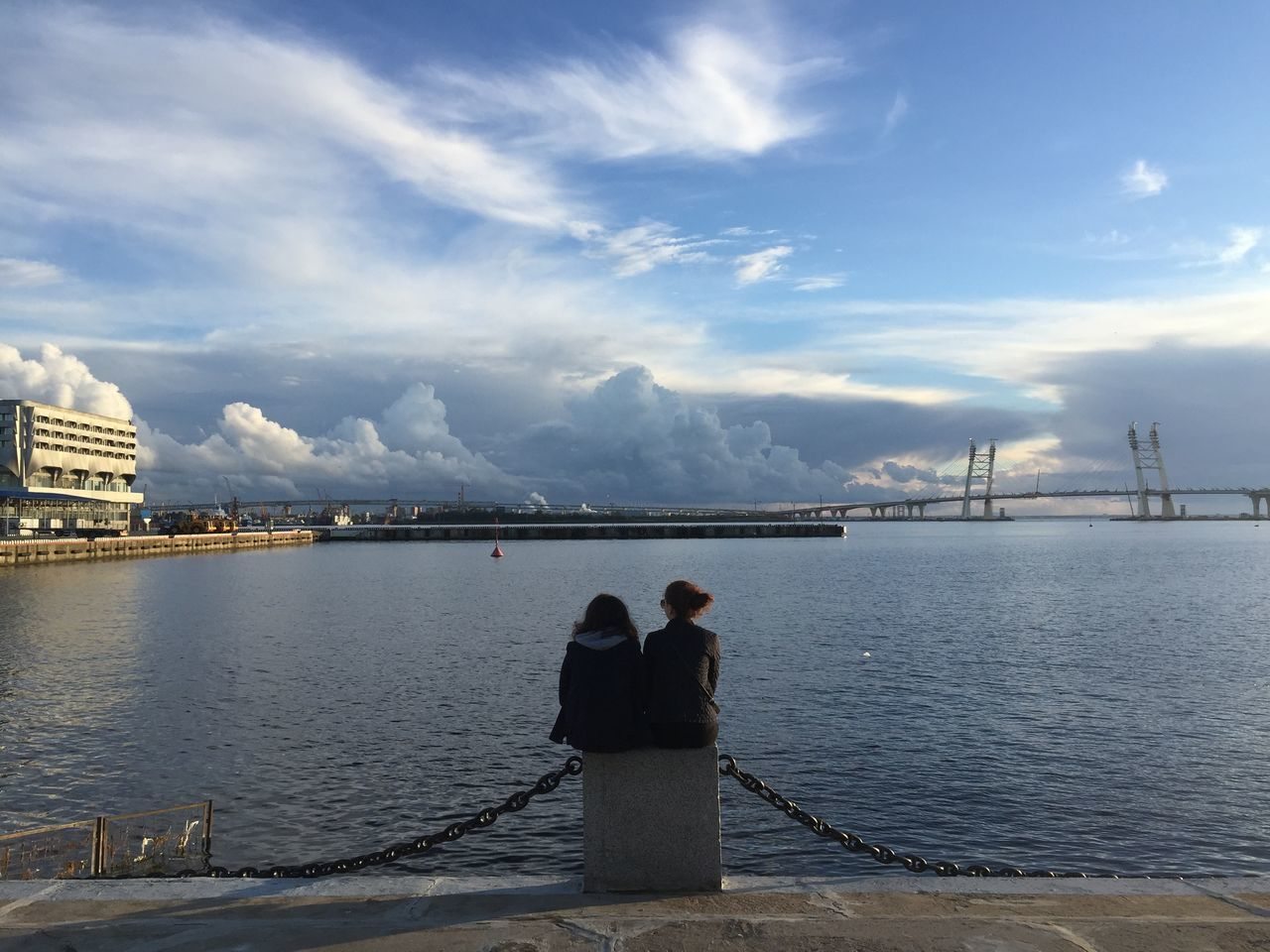 Enjoying sunset in Saint Petersburg Haven Architecture Bridge - Man Made Structure Building Exterior Built Structure City Cloud - Sky Connection Day Lifestyles Men Nature No People Outdoors People Real People Rear View Russia Saint Petersburg Sky Sunset Togetherness Two People Water Women