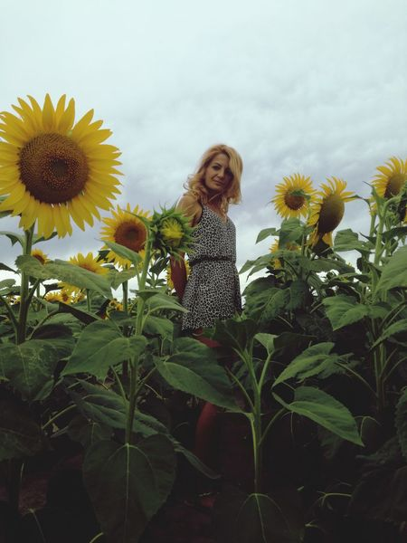 One Person Blond Hair Flower Growth Outdoors Day Nature Sky Portrait Adult EyeEm Best Shots - Nature One Woman Only Beautiful Women ♥ Women Of EyeEm Beauty In Nature Nature Plant Growth Fashion Womenpower Cloud - Sky Beautiful Woman Rural Scene Summer Long Hair