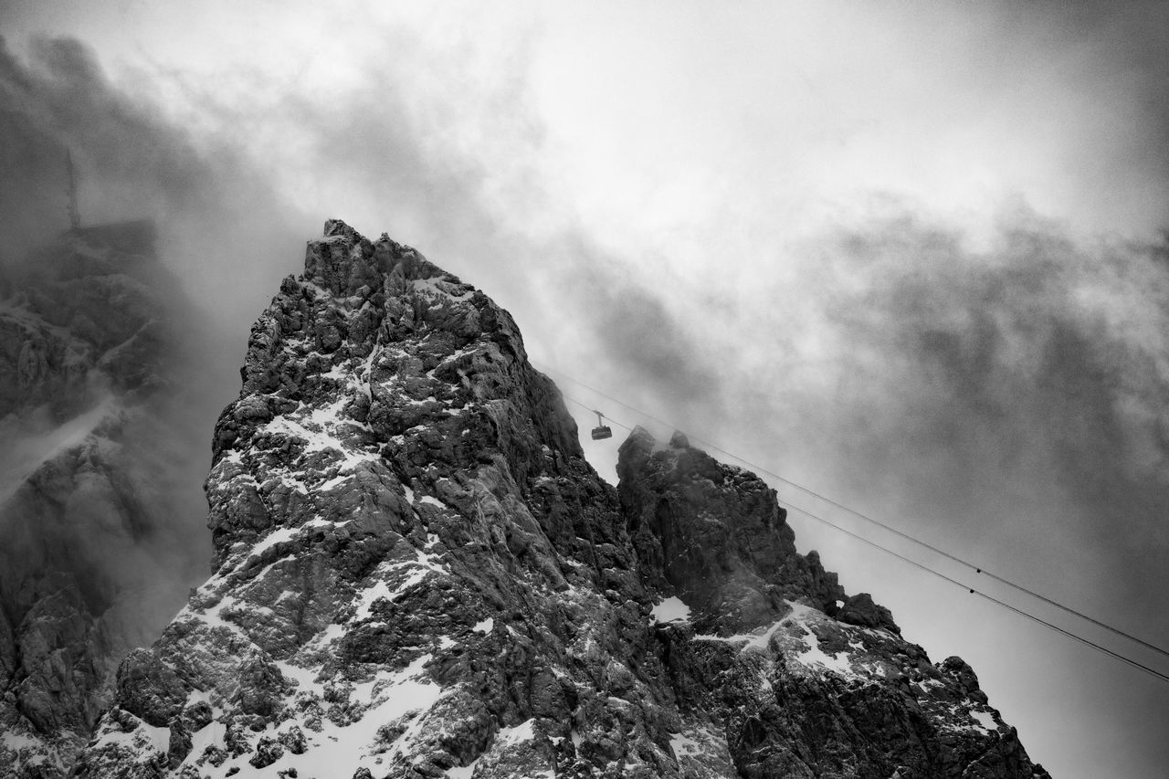 Alps Bavaria Beauty In Nature Cable Car Cloud - Sky Clouds Cold Temperature Day Geology Landscape Low Angle View Mountain Mountain Peak Nature No People Outdoors Physical Geography Scenery Scenics Sky Snow Tranquil Scene Tranquility Winter Zugspitze