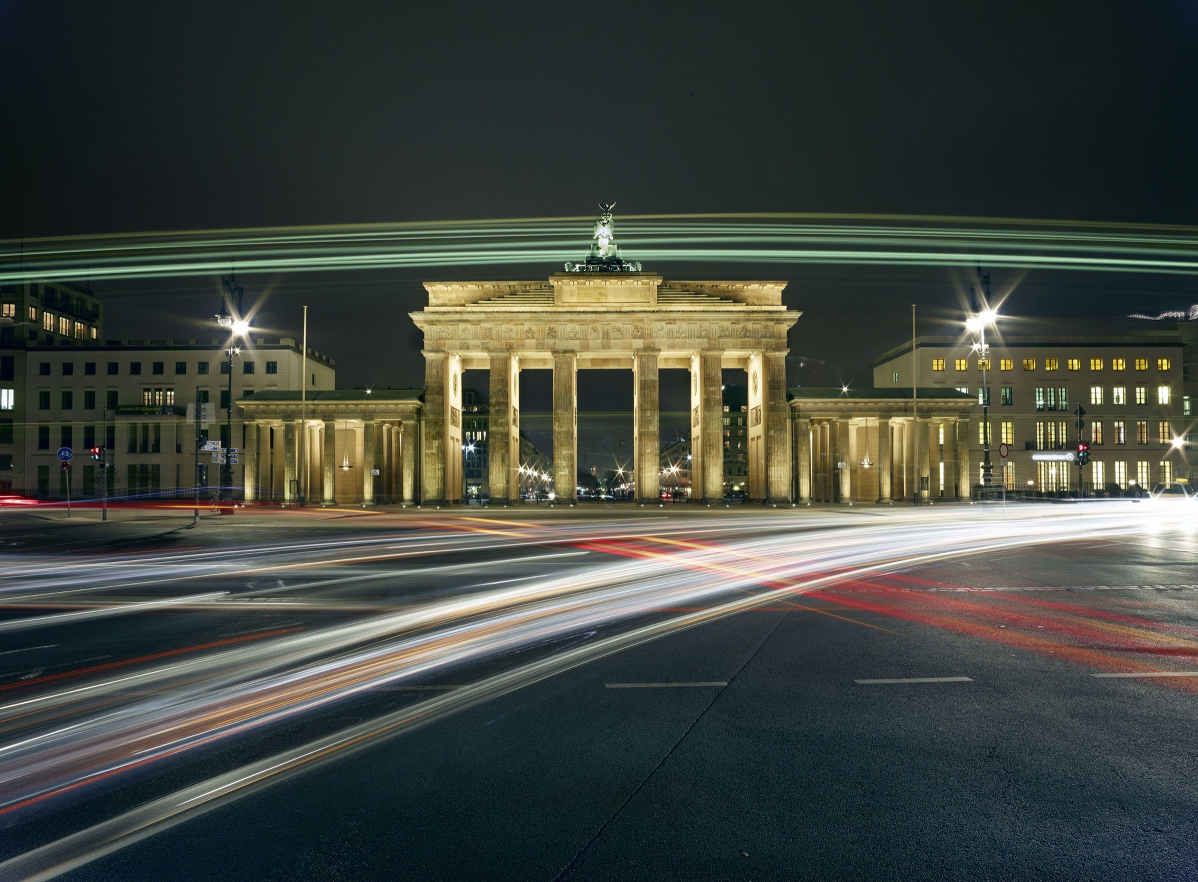 illuminated, night, architecture, built structure, building exterior, light trail, transportation, long exposure, road, street, city, motion, road marking, blurred motion, travel destinations, travel, speed, city life, the way forward, lighting equipment