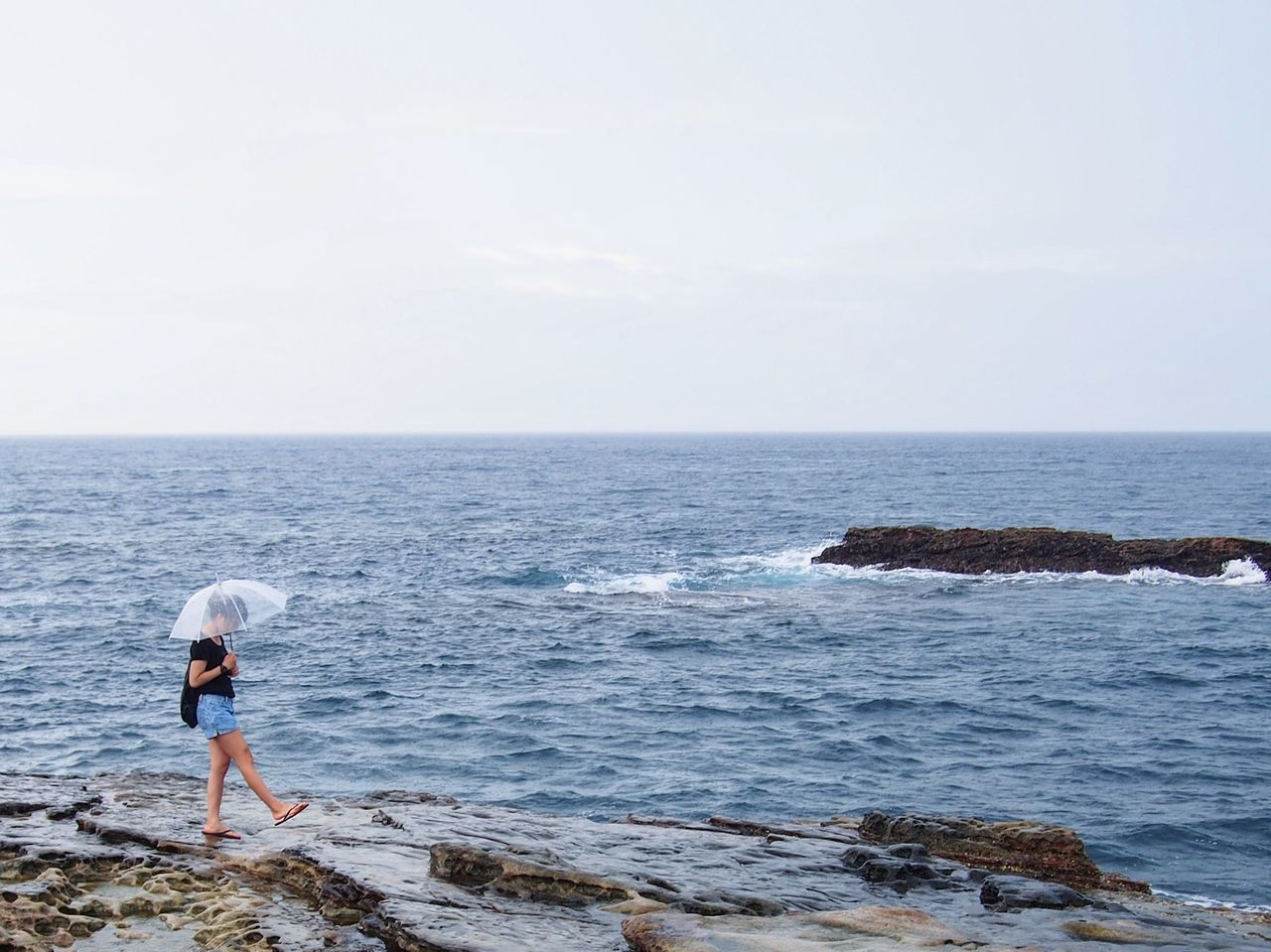 sea, one person, horizon over water, full length, water, real people, rear view, standing, nature, beauty in nature, scenics, day, casual clothing, sky, outdoors, leisure activity, women, young adult, adult, people, adults only