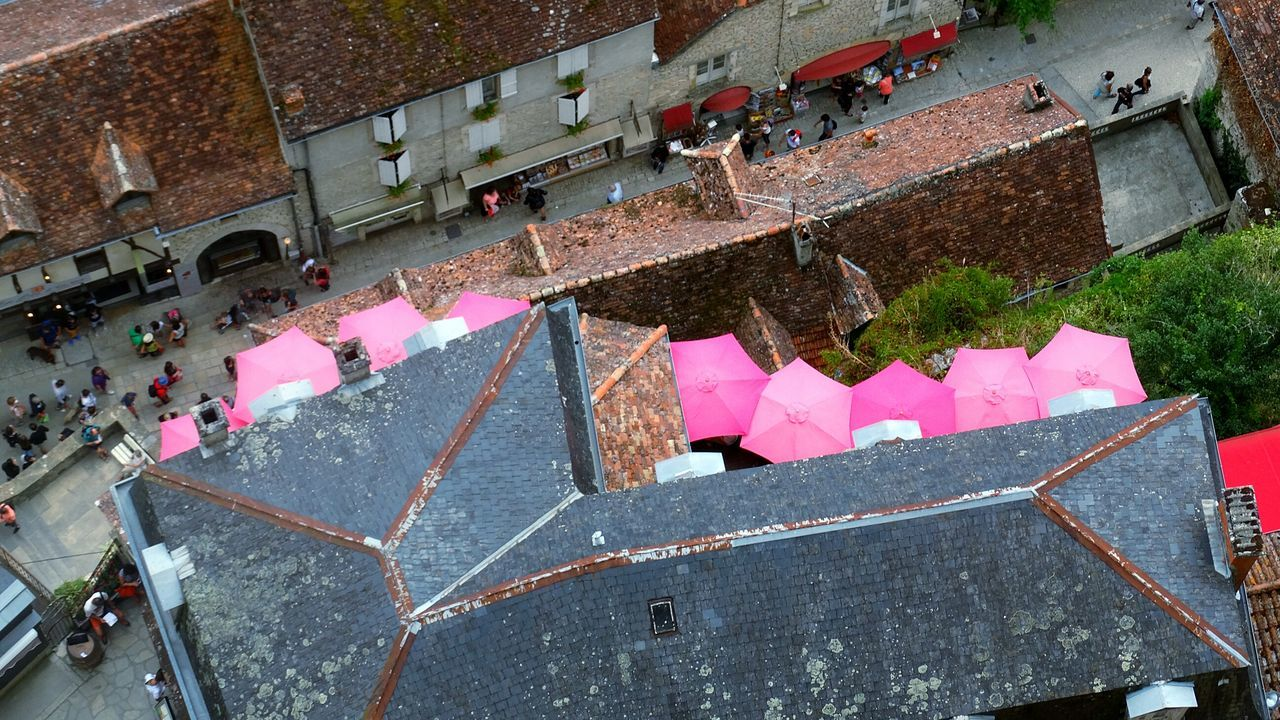 Pink umbrellas. High Angle View Lazy Afternoon From My Point Of View Rocamadour Leisure Activity Elevated View A Birds's Eye View French Lifestyle Overhead View Lot Tourisim Pink Umbrellas Pink Umbrella Pink Unbrellas Cafe Cafe Bar Brasserie