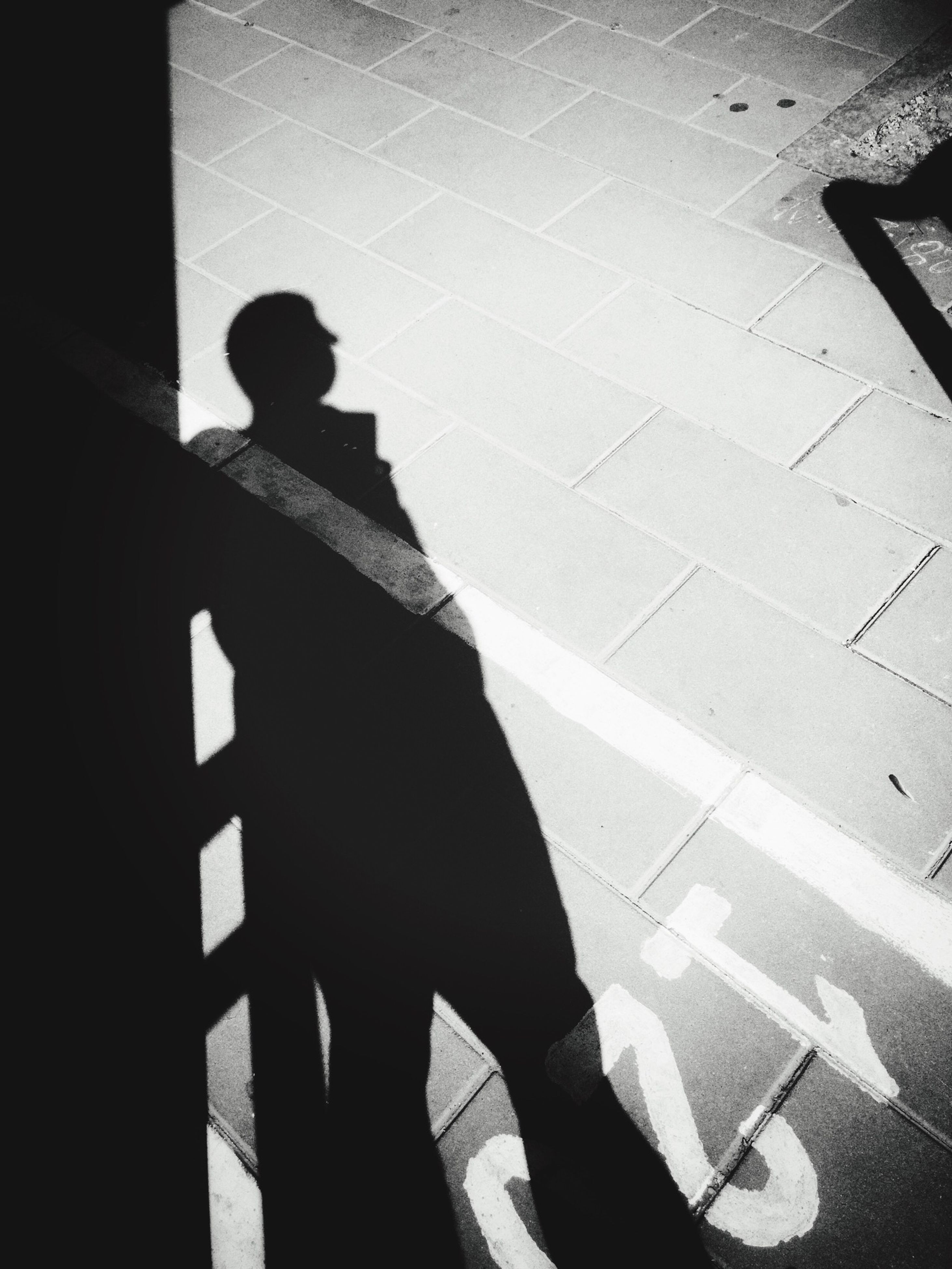 shadow, silhouette, men, lifestyles, sunlight, standing, unrecognizable person, focus on shadow, built structure, architecture, high angle view, auto post production filter, indoors, leisure activity, low section, transfer print, person, day