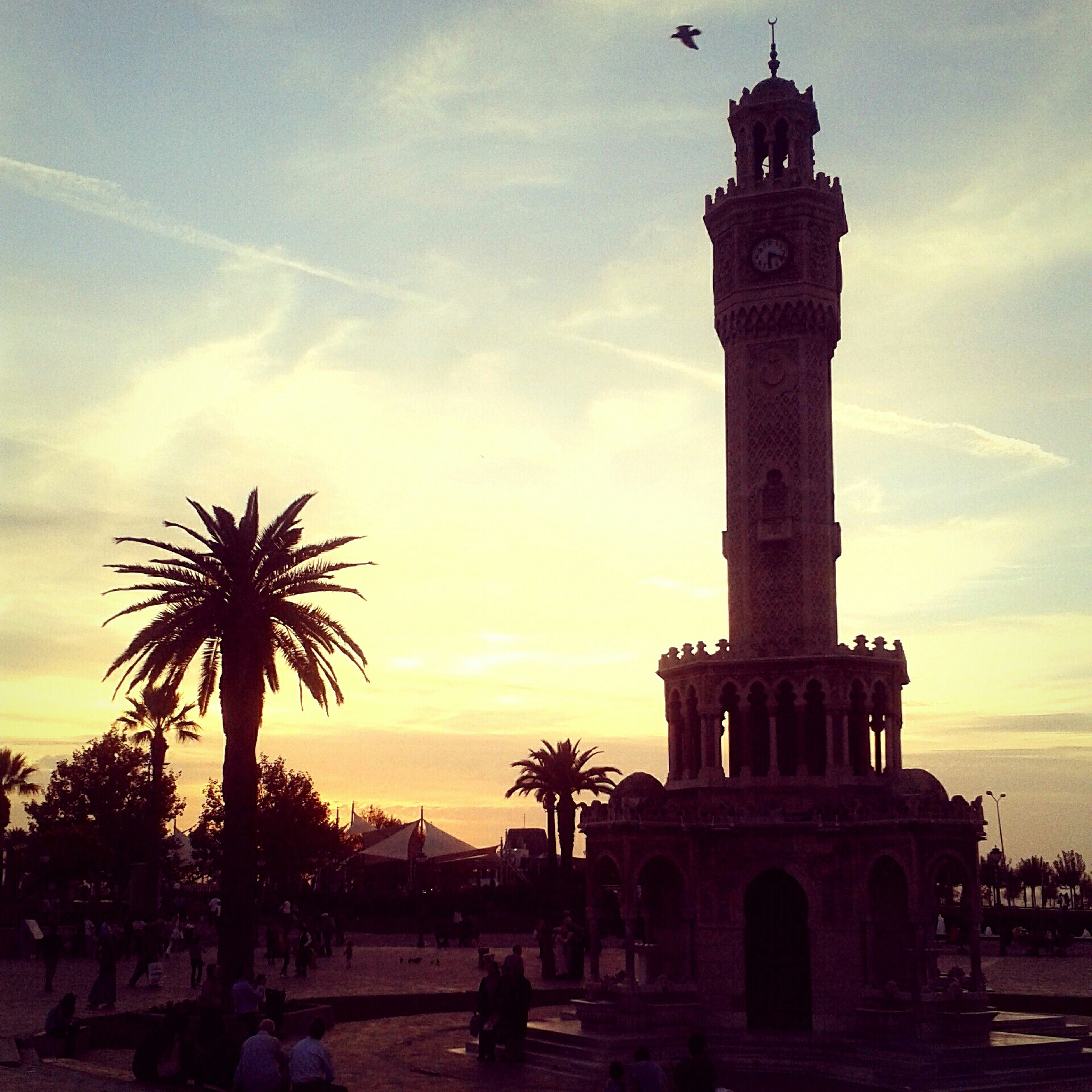 sunset, architecture, built structure, sky, building exterior, silhouette, palm tree, famous place, incidental people, tourism, travel destinations, history, travel, tree, tower, sea, cloud - sky, religion, tourist, place of worship