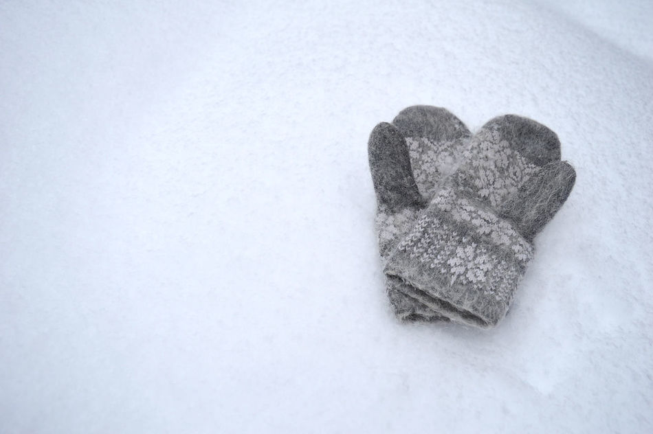 Grey wool gloves on the snow Close-up Clothing Cold Temperature Comfortable Craft Day Fluffy Frost Glove Gray Heart Shape Holiday Mittens Nature No People Outdoors Pattern Protection Snow Textile Weather White Background Winter Wool