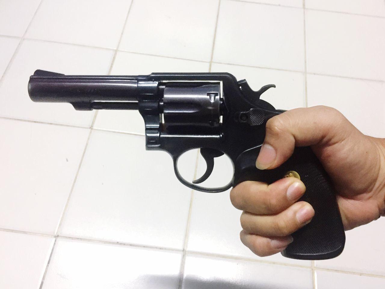 gun, human hand, handgun, weapon, human body part, danger, one person, indoors, close-up, day