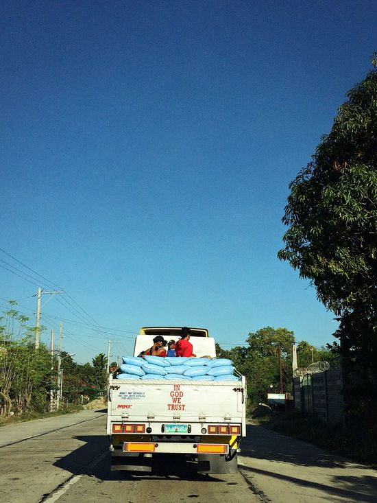 Blue Car Clear Sky Day Delivery Green Land Vehicle Mode Of Transport No Clouds Old-fashioned Outdoors Province Road Sky Town Tranquility Transportation Travel Tree Truck Work Worker The City Light The Great Outdoors - 2017 EyeEm Awards