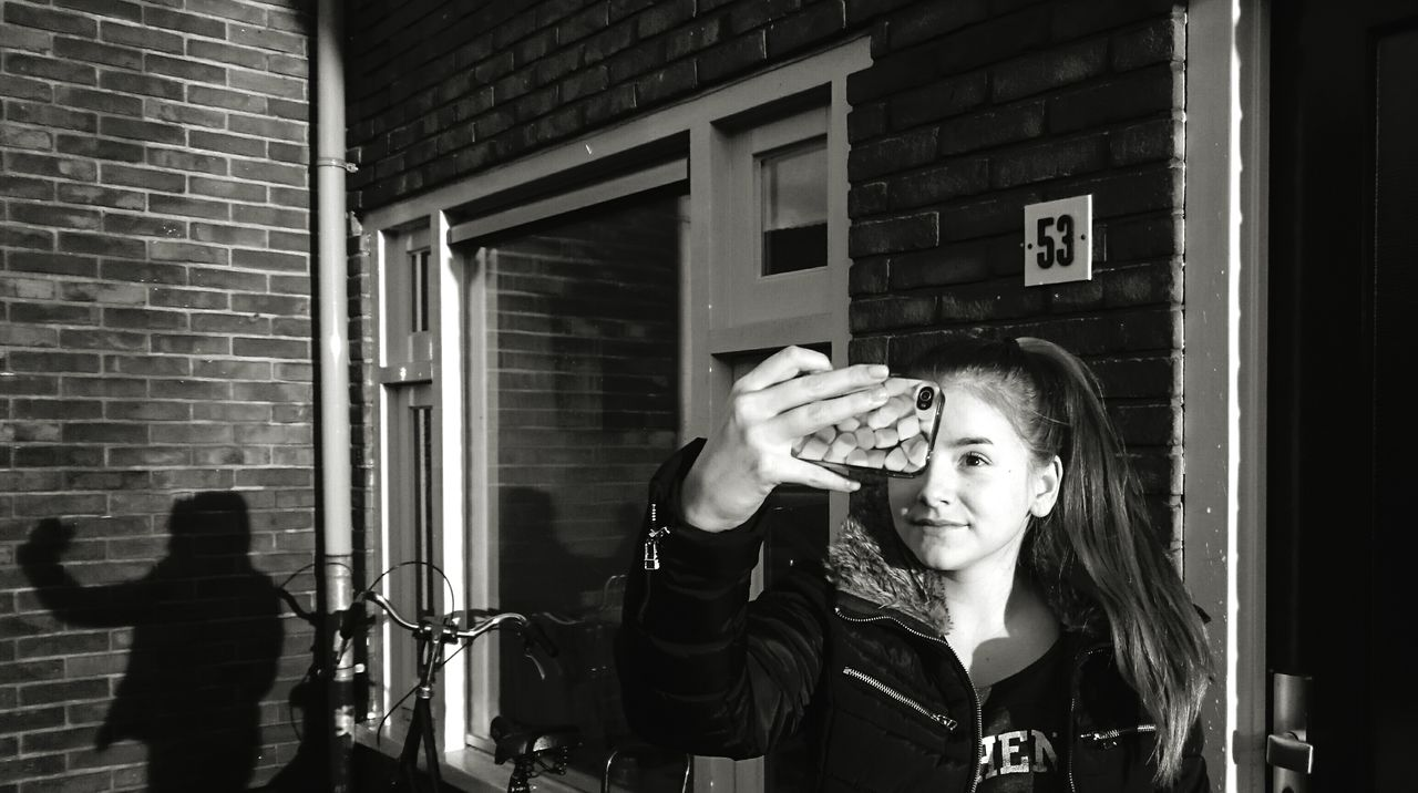 Taking Photos Younggirl Selfie ✌ Sunlight Sunlight And Shadow Mobilephotography Streetphotography Outside Photography ProudOfMyself Makingfun Wall Bricks Window Light And Shadow Blackandwhite Black & White B&w ThatsMe Identity Shadows Showcase: November The Street Photographer - 2016 EyeEm AwardsLookatme Picturing Individuality B&w Street Photography The City Light