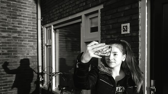 Taking Photos Younggirl Selfie ✌ Sunlight Sunlight And Shadow Mobilephotography Streetphotography Outside Photography ProudOfMyself Makingfun Wall Bricks Window Light And Shadow Blackandwhite Black & White B&w ThatsMe Identity Shadows Showcase: November The Street Photographer - 2016 EyeEm AwardsLookatme Picturing Individuality B&w Street Photography
