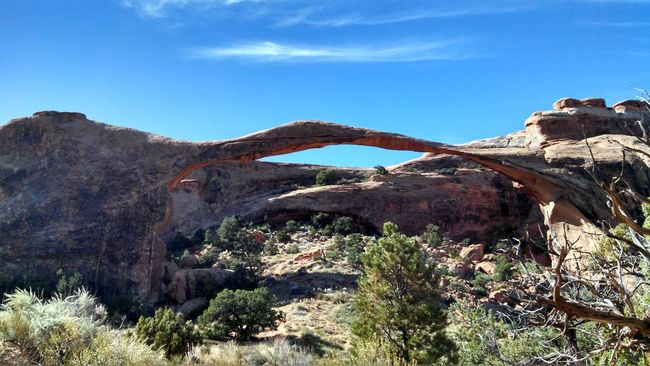 #arches #nationalpark #redrock #Utah Beauty In Nature Blue Built Structure Day Landscape Low Angle View Mountain Nature Non-urban Scene Outdoors Plant Rock Rock - Object Rock Formation Rocky Mountains Scenics Sky Sunlight Tranquil Scene Tranquility