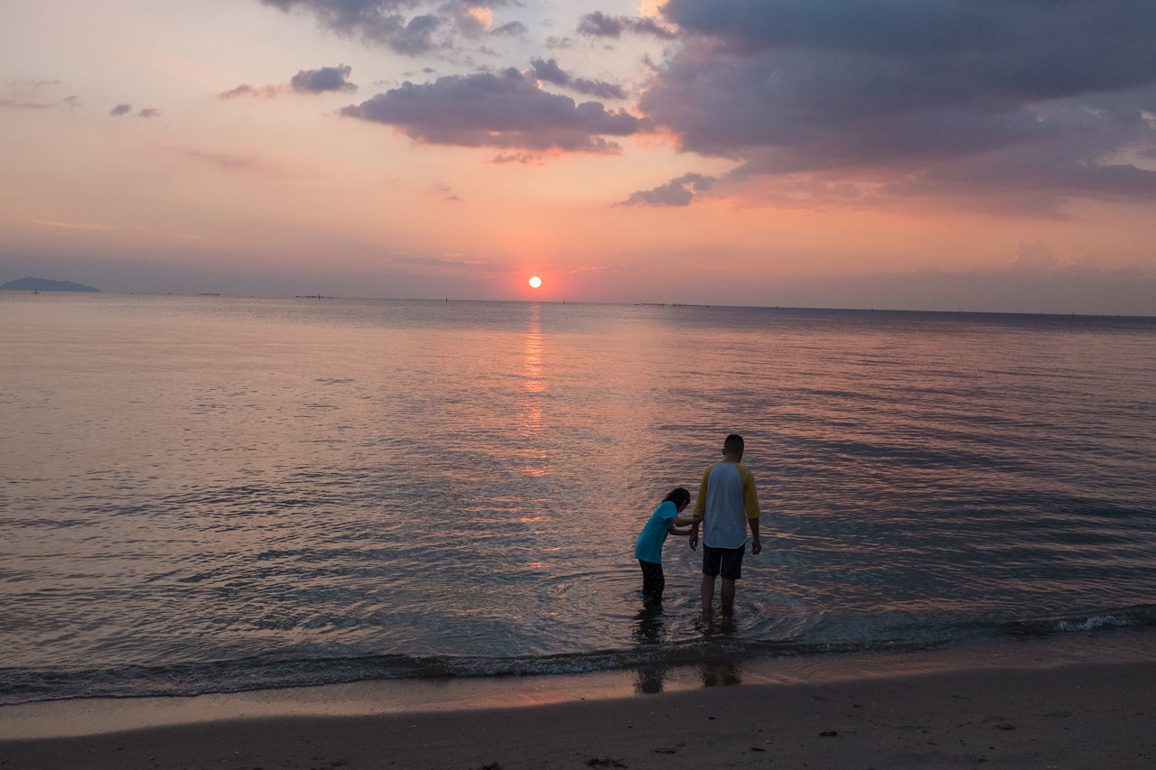 sea, sunset, water, two people, sky, cloud - sky, togetherness, beach, horizon over water, outdoors, beauty in nature, nature, real people, scenics, fisherman, full length, tranquility, men, day, people, adult
