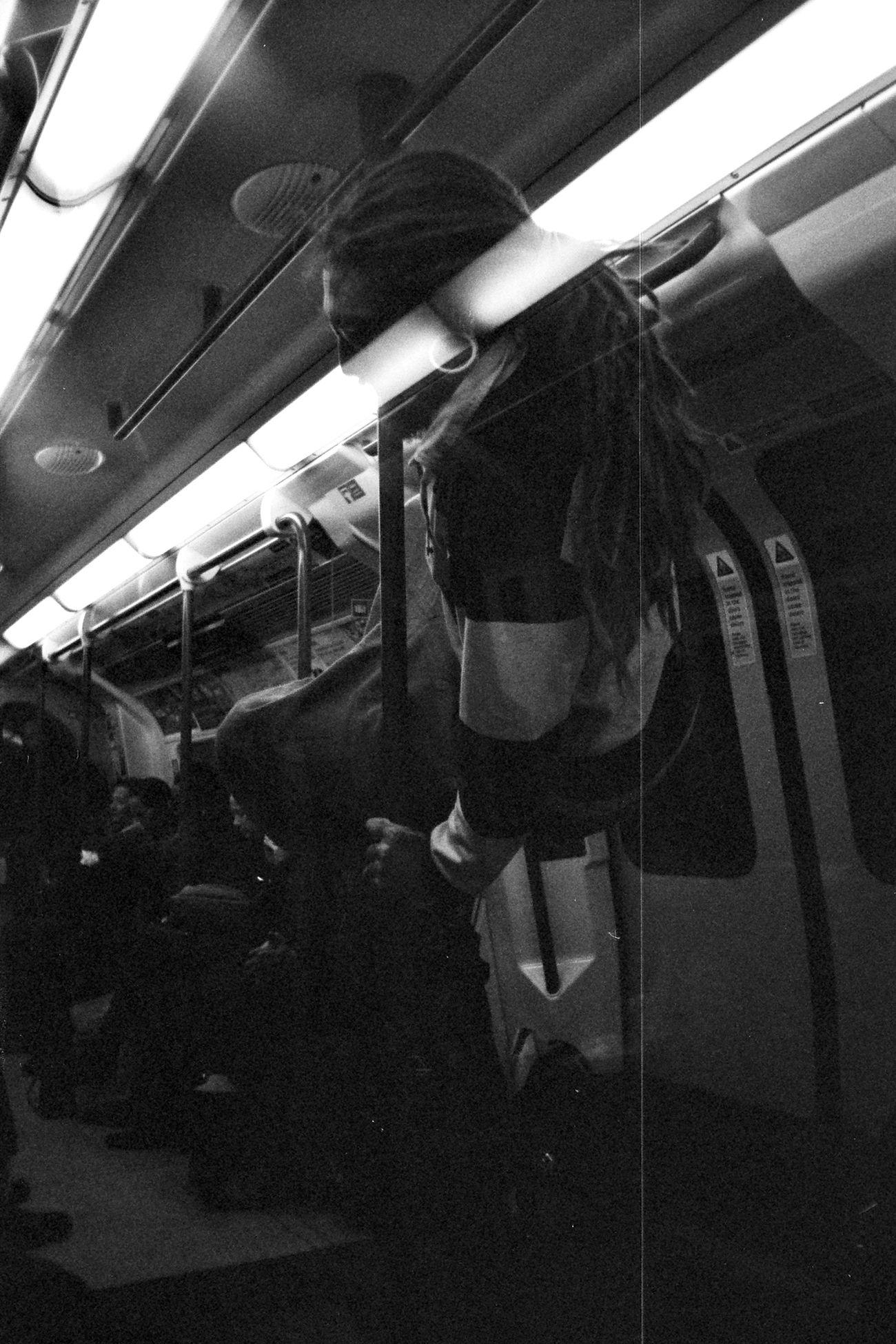 Adult Blackandwhite Bw Camden Town Station Dread Dreadlocks Dreads Fun Funny Hanging Indoors  Light London Lifestyle Mode Of Transport Monkey Business Passenger Train People Public Transportation Rail Transportation RASTA Rastafari Train - Vehicle Transportation Travel Underground