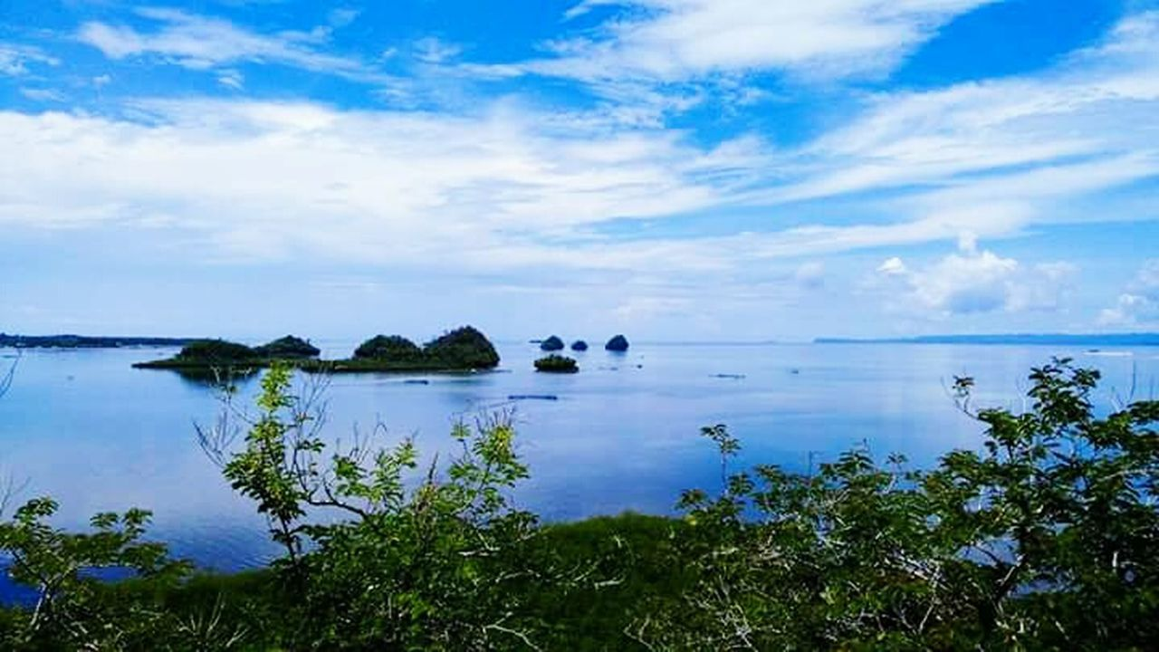 sky, scenics, tranquil scene, sea, cloud - sky, nature, tranquility, blue, outdoors, beauty in nature, water, no people, horizon over water, day, plant, tree, beach