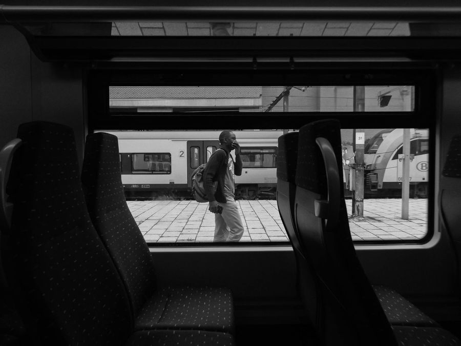 Walking By. Day Journey Lifestyles Man Candid Daily Life Mode Of Transport Passenger Railway Public Transportation Transportation Commuting Conceptual Photography  Conceptual Daily Commute Public Transportation Seat Window Window Reflection