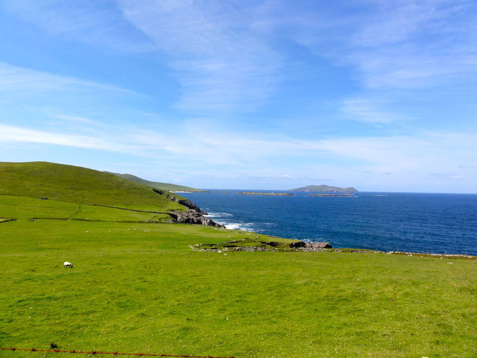 Beauty In Nature Blue Cliff Coastline Distant Exploring EyeEm Gallery EyeEm Nature Lover Green Horizon Over Water Ireland North Atlantic Ocean Ocean Outdoors Peasture Scenics Sea Tranquil Scene Tranquility Vacation Water Landscape With Whitewall