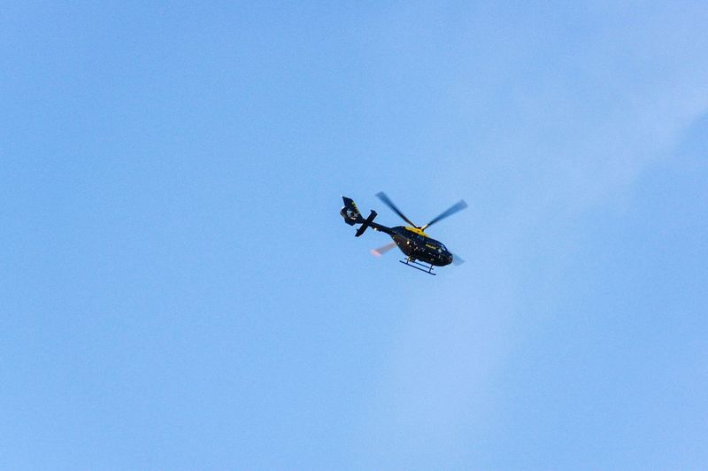 Police Helicopter Police Pursuit  Survailance Helicopter Blue Sky Clouds Danger Low Angle View Outdoors Day RISK Nature Clear Sky