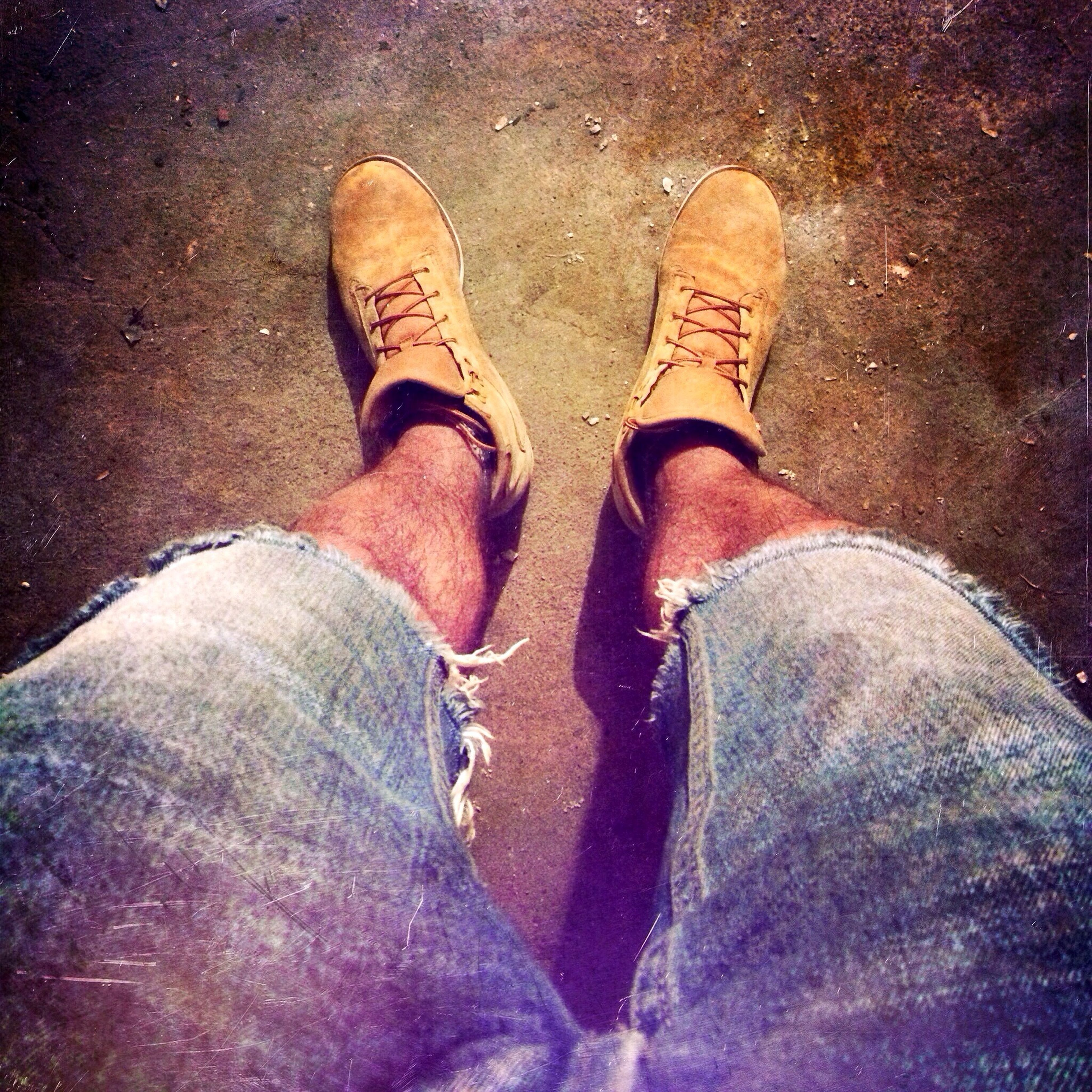 low section, person, personal perspective, shoe, lifestyles, human foot, high angle view, leisure activity, men, standing, footwear, jeans, togetherness, unrecognizable person, street