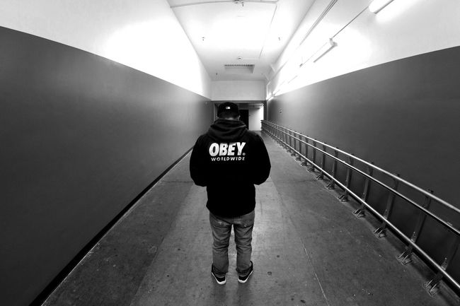 Casual Clothing Diminishing Perspective Fashion Front View Full Length Illuminated In Front Of Indoors  Mask - Disguise Modern Narrow OBEY Standing The Way Forward Tunnel Wall - Building Feature Young Adult