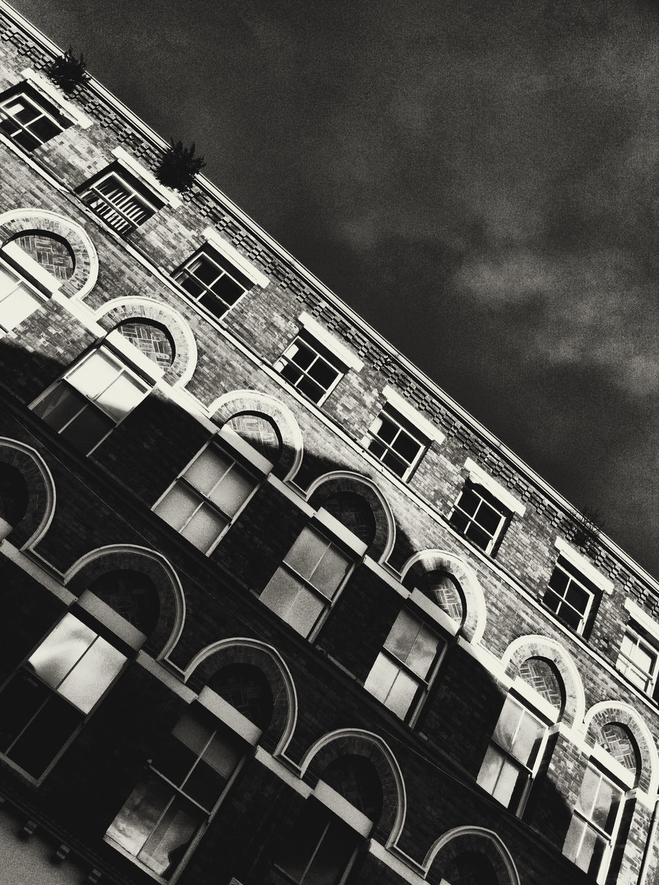 architecture, low angle view, building exterior, built structure, facade, outdoors, no people, window, day, sky, city