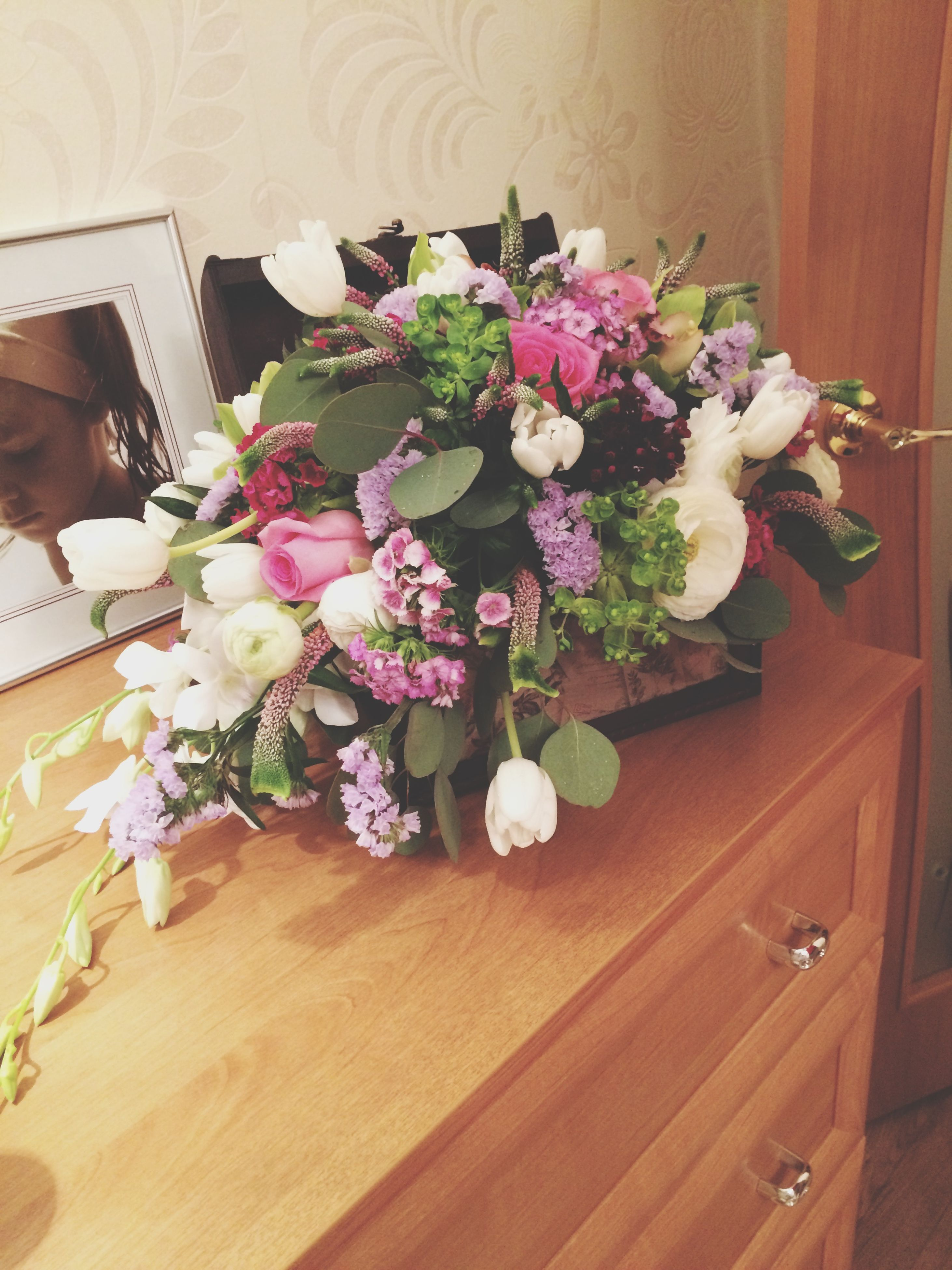 flower, indoors, freshness, wood - material, table, fragility, petal, vase, high angle view, wooden, flower arrangement, bunch of flowers, bouquet, flower head, beauty in nature, decoration, home interior, growth, plant, still life