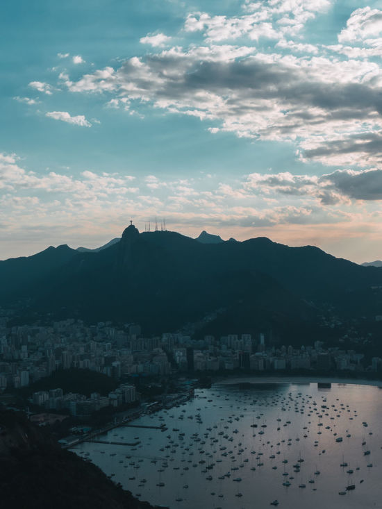 Beauty In Nature Christ The Redeemer Cityscape Cloud - Sky Day Mountain Nature No People Ocean Outdoors Rio De Janeiro Scenics Sea Sea And Sky Sky Sky And Clouds Sugarloaf Sugarloafmountain Summer Sunset Travel Travel Destinations Water