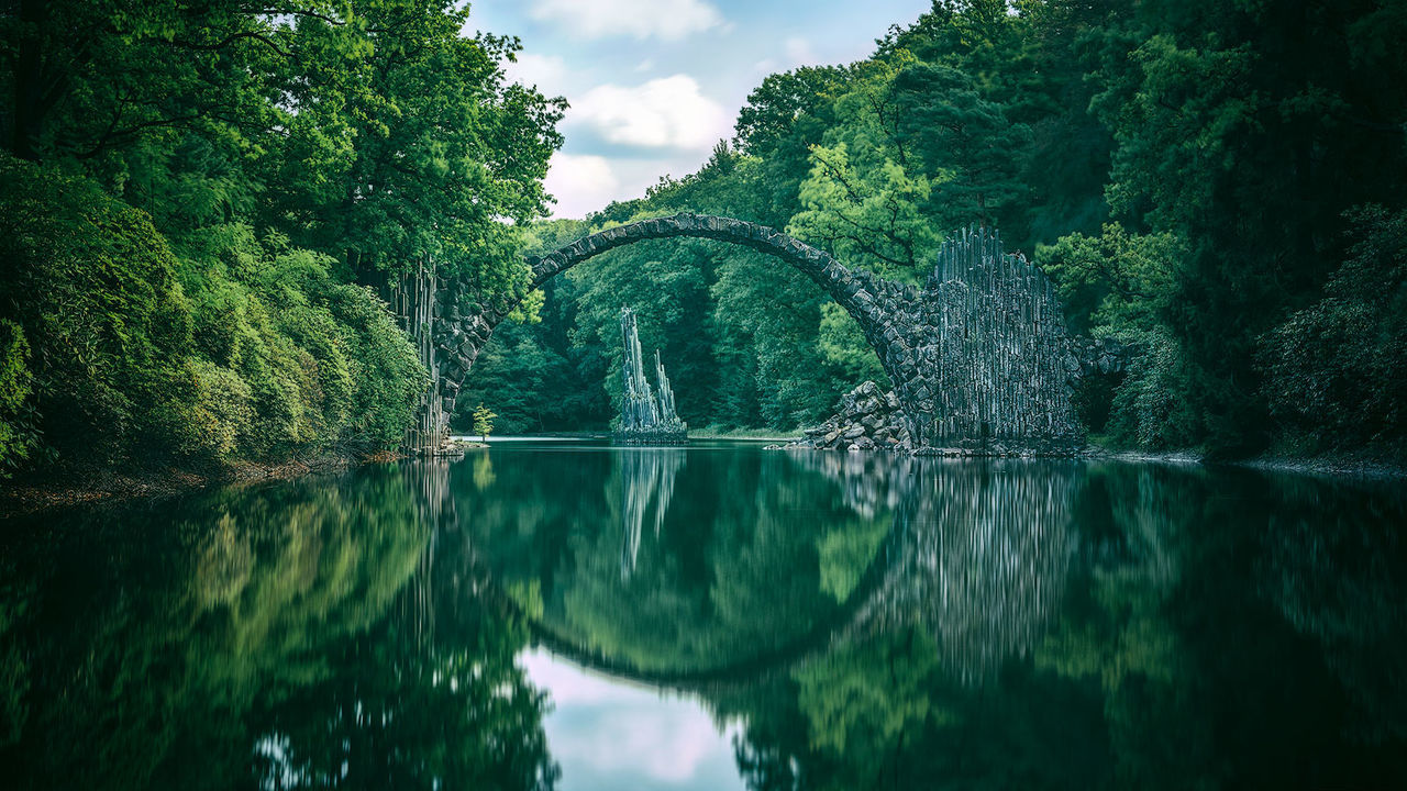 Beauty In Nature Bridge Day Green Color Growth Lake Nature No People Outdoors Rakotz Rakotzbridge Rakotzbrücke Reflection Scenics Sky Tranquil Scene Tranquility Tree Water Waterfront