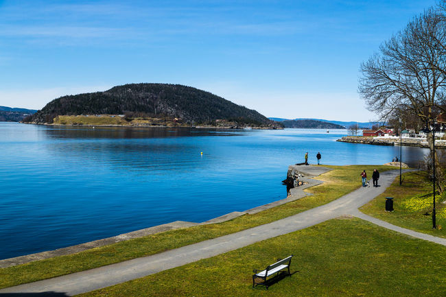 Beauty In Nature Blue Day Drøbak Grass Idyllic Incidental People Lake Mountain Mountain Range Nature Norway River Scenics Sea Sky Sunlight Tranquil Scene Tranquility Transportation Travel Traveling Tree Water