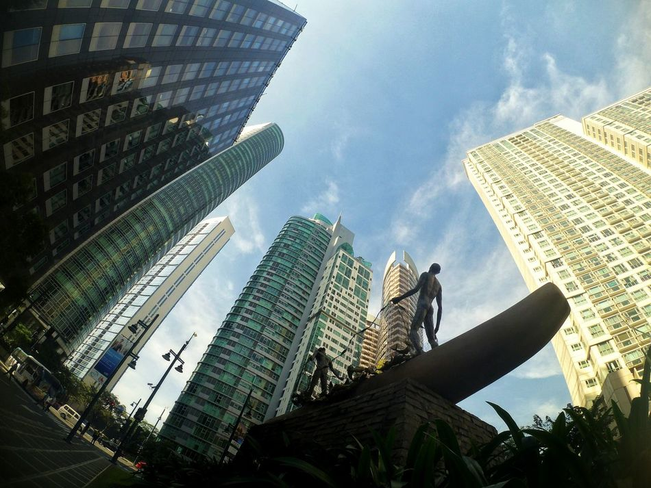 We are the fisherfolks. Skyscraper City Architecture Low Angle View Urban Skyline Building Exterior Modern Cityscape Outdoors Financial District  Business Finance And Industry Business No People Office Building Exterior Day Downtown District Futuristic Sky Tree Eyeem Philippines Architecture Travel Destinations City Skyline Cityscape