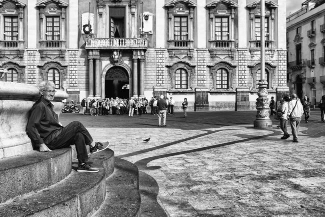 Catania, Italy - October 23, 2015: One Sicilian elderly lonely sitting on the stairs elephant fountain in the square, in the city center of Catania in Sicily, Italy Aged Alone Black And White Catania Elder Fountain Italy Man Monument My Favorite Place Place Relax Relaxation Senior Sicily Sitting Stears Street Street Photography Streetphotography