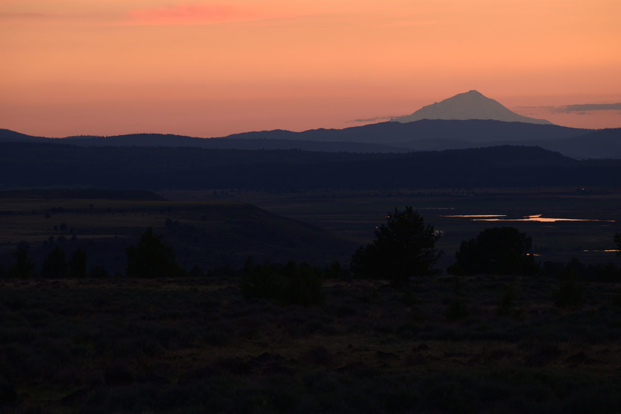 Mount Shasta silhouetted by orange sunset. Background Beautiful Beauty In Nature Black Space Environment Glow Landscape Light Mountain Nature No People Orange Background Outdoors Panorama View Scene Silhouette Sky Sunset Tranquil Scene Tranquility View Wild