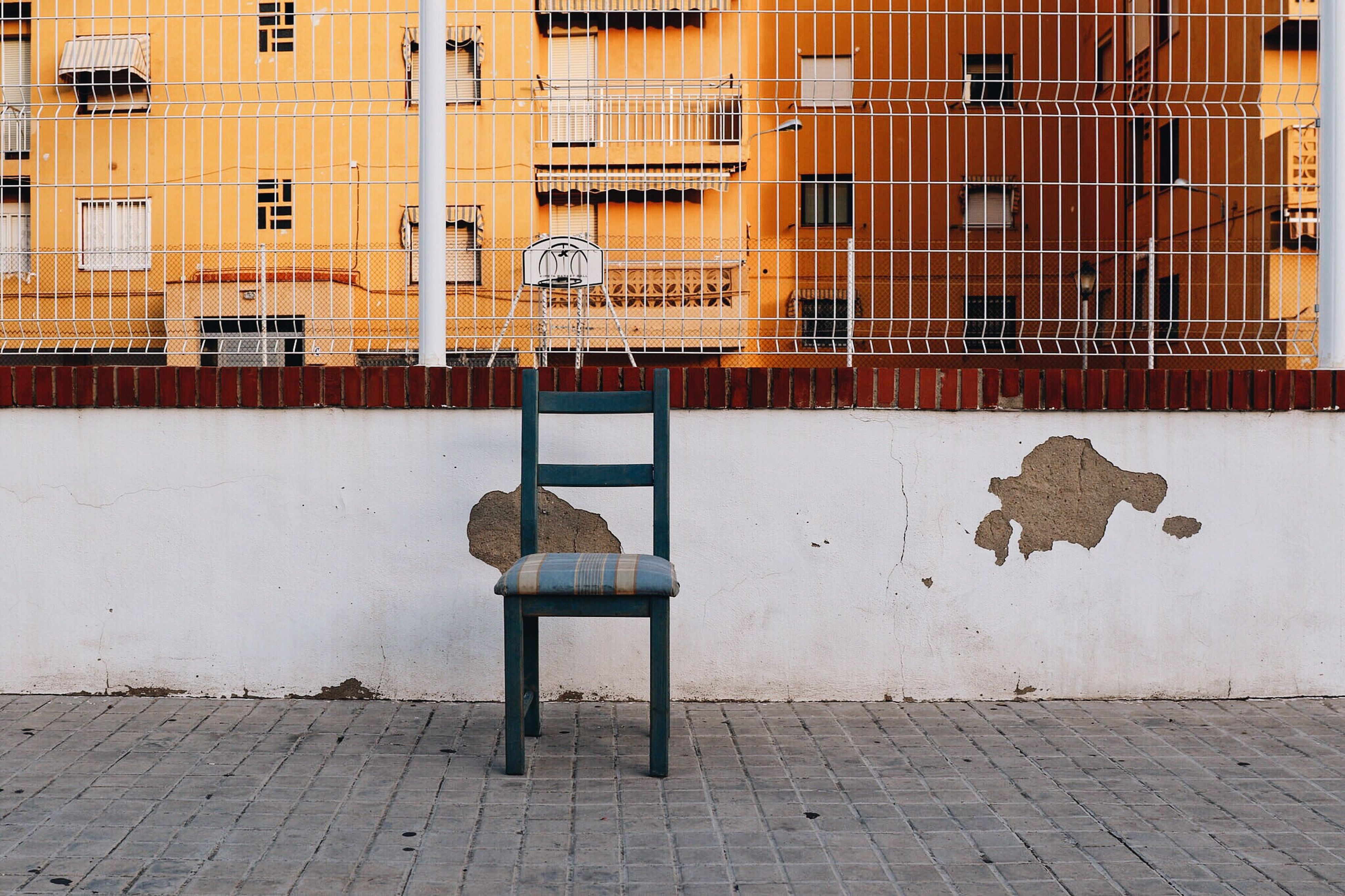 View Of An Empty Chair Against Built Structure