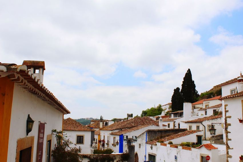 Architecture Building Exterior Built Structure Sky Cloud - Sky House Residential Building Day Outdoors Low Angle View Roof No People Town Tree City Óbidos  Obidos Portugal Portugal Medieval Architecture Live For The Story The Street Photographer - 2017 EyeEm Awards