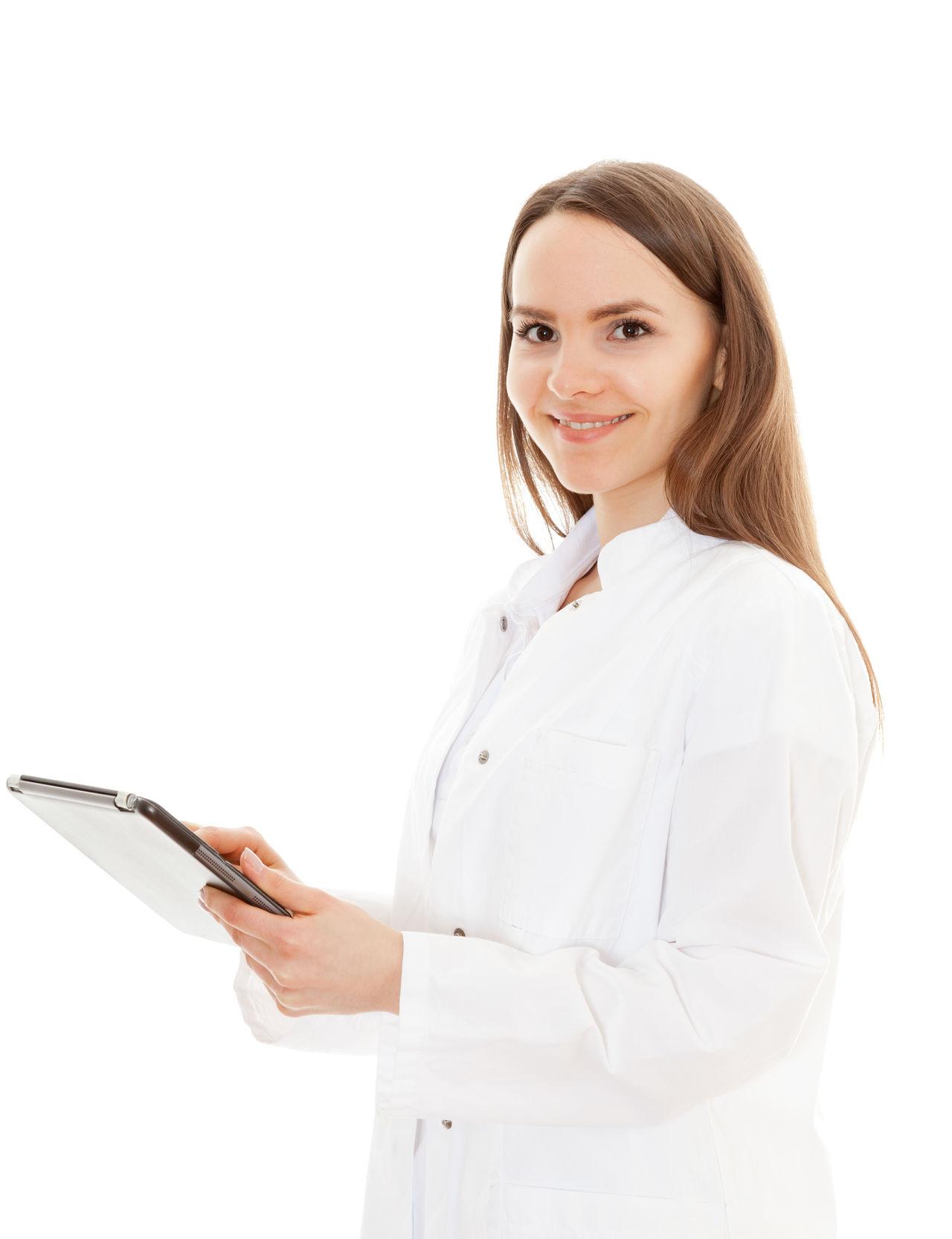 Female doctor holding tablet device on white background Brunette Career Doctor  Med School Med Student Medical Personnel Medical Staff Medical Student Physician Studio Shot Tablet Tablet Computer Tablet Device White Background Young Adult