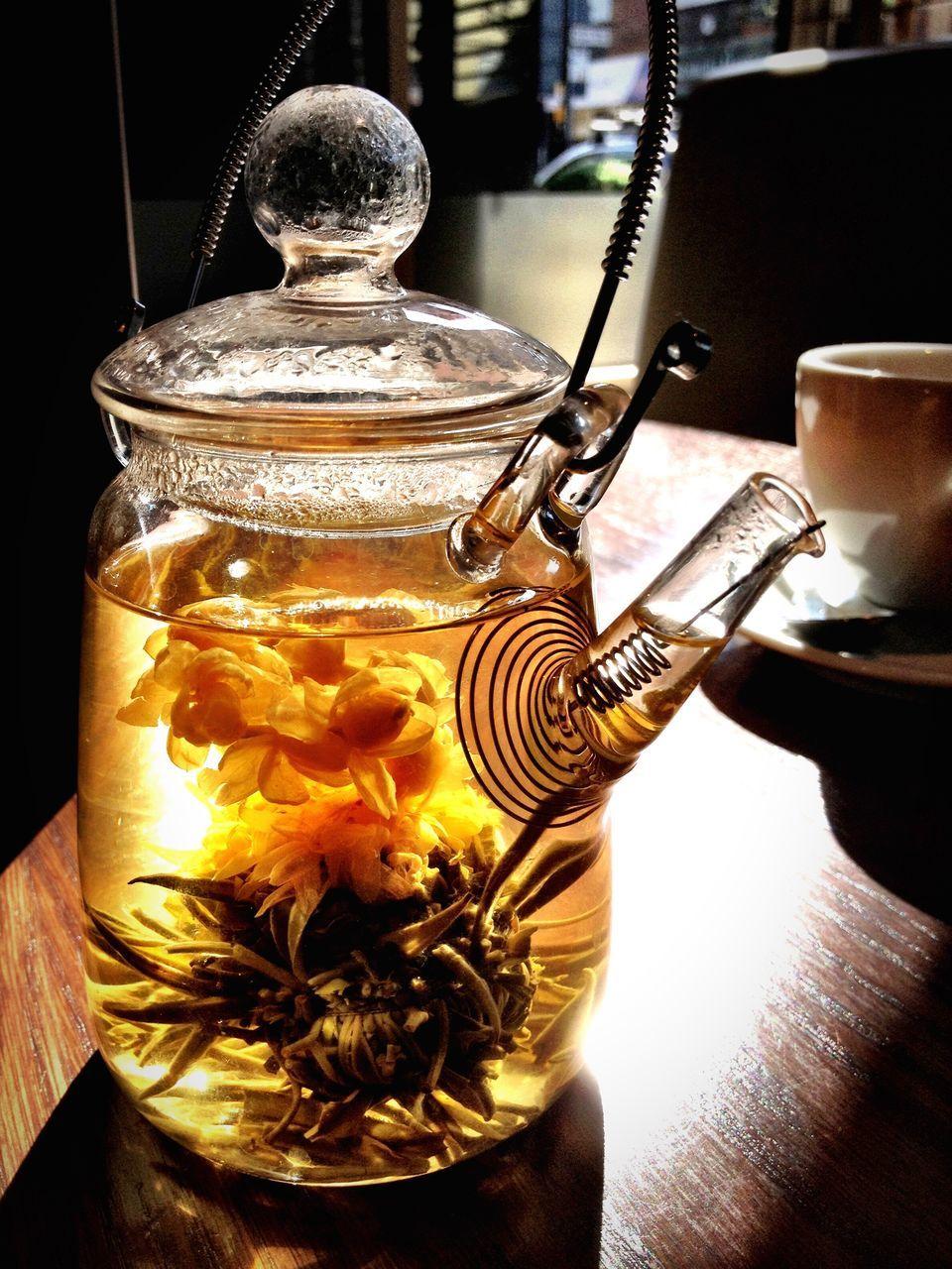 Close-Up Of Jasmine Teapot On Table