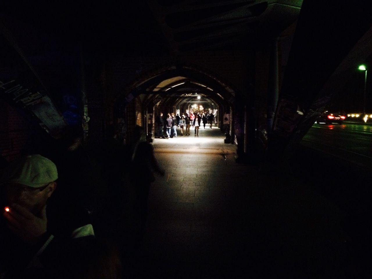 People Walking In Archway By Street